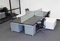 Picture of Cluster of 4 Person Bench Seating Teaming Workstation with Filing Storage and Power Management